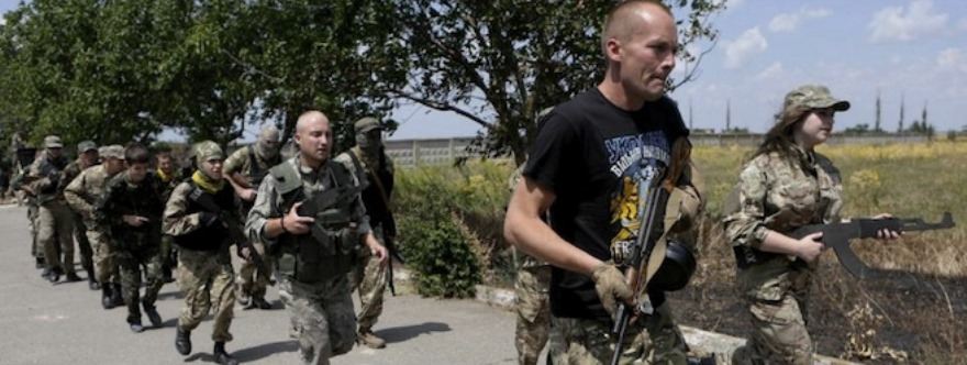 In this photo taken on Thursday, June  25, 2015, members of a self-defense unit for Odessa, Ukraine, carry out exercise drills in a location outside the Odessa, Ukraine. Odessa lies more than 500 kilometers (300 miles) west of the front line in east Ukraine, where government troops are mired in a war of attrition against Russian-backed separatists. (AP Photo/Sergei Chuzavkov)