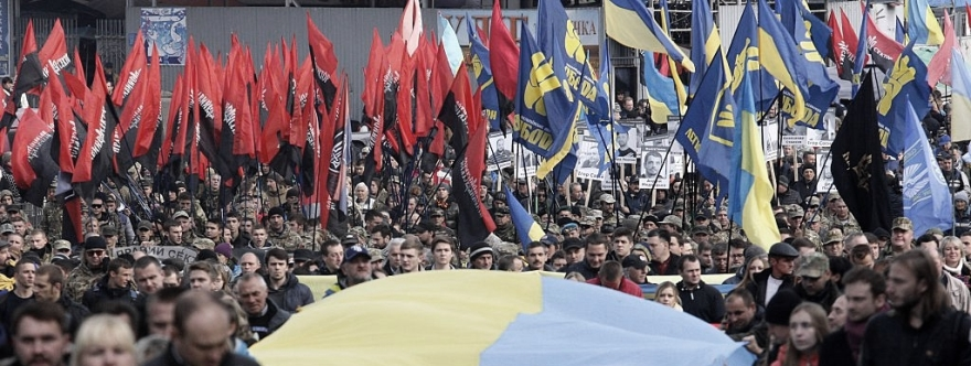 Supporters of nationalists parties carry a huge Ukrainian national flag during a rally in Kiev on October 14, 2015, to mark Ukrainian Defender's Day and the founding of the Ukrainian Insurgent Army (UPA), a paramilitary partisan movement formed in 1943 to battle for independence against Polish, Soviet and German forces in western Ukraine. AFP PHOTO / ANATOLII STEPANOV