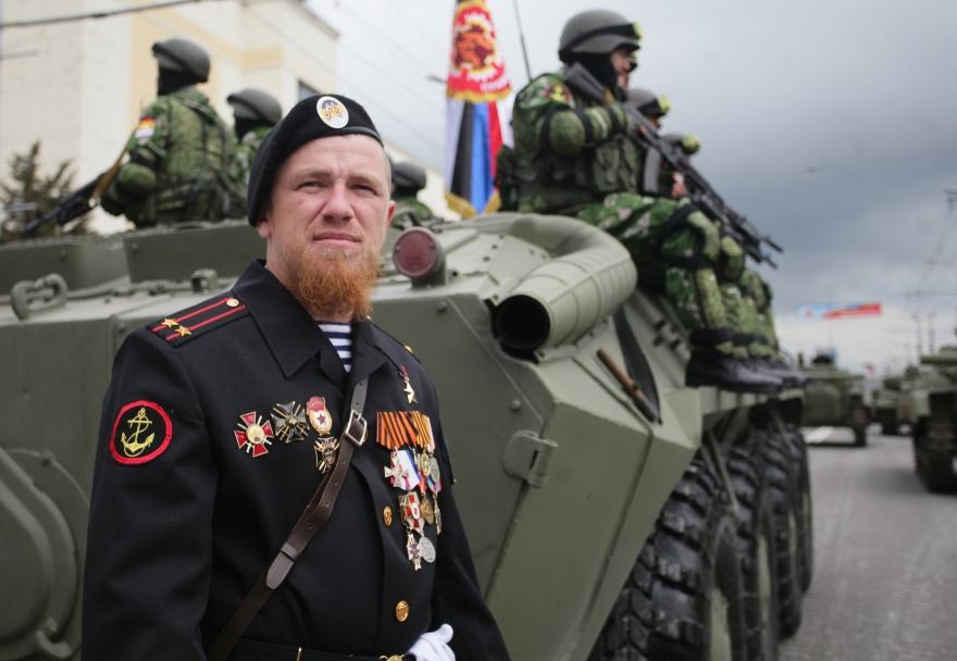 """DONETSK, UKRAINE. MAY 9, 2015. Donetsk People's Republic (DPR) militiaman Arsen Pavlov, nicknamed """"Motorola"""" seen ahead of a Victory Day military parade marking the 70th anniversary of the Victory over Nazi Germany in the Great Patriotic War of 1941-1945. Mikhail Sokolov/TASS Óêðàèíà. Äîíåöê. 9 ìàÿ 2015. Âåîííîñëóæàùèé àðìèè ÄÍÐ ñ ïîçûâíûì """"Ìîòîðîëà"""" Àðñåí Ïàâëîâ ïåðåä íà÷àëîì âîåííîãî ïàðàäà, ïîñâÿùåííîãî 70-é ãîäîâùèíå Ïîáåäû â Âåëèêîé Îòå÷åñòâåííîé âîéíå. Ìèõàèë Ñîêîëîâ/ÒÀÑÑ"""